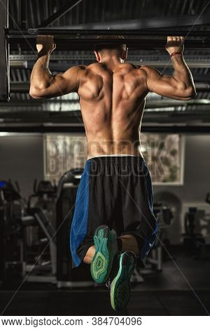 Get Fit Now. Rearview Vertical Full Length Shot Of An Athletic Shirtless Man With Strong Toned Body