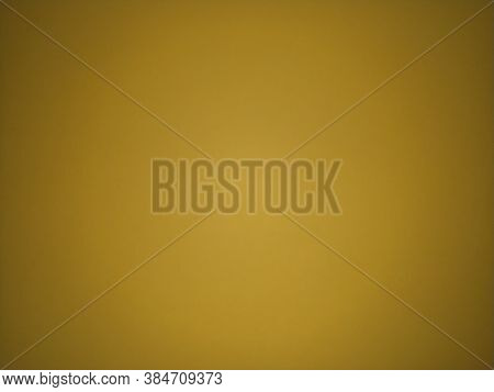Ocher Color Background. Colored Paper Dimly Lit In The Middle. Light Dark Vignetting Around The Edge