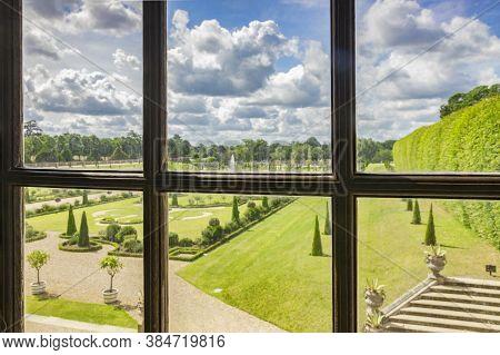 9 June 2019: Richmond, Uk - A View Through A Window Of Hampton Court Palace, Of The Privy Garden. Fo