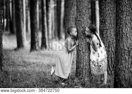 Two little girls in the park. Black and white photo.