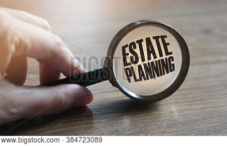 Estate Planning Words Under , Agnifying Glass On Wooden Table. Real Estate Business Concept
