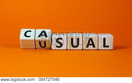 Turned A Cube And Changed The Word Usual To Casual. Beautiful Orange Background. Business Concept, C