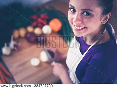 A Young Woman Cooking In The Kitchen.