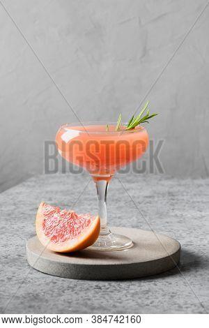 Honey Rosemary Grapefruit Sodas Or Lemonade Garnish Rosemary On Light Grey. Vertical Format.
