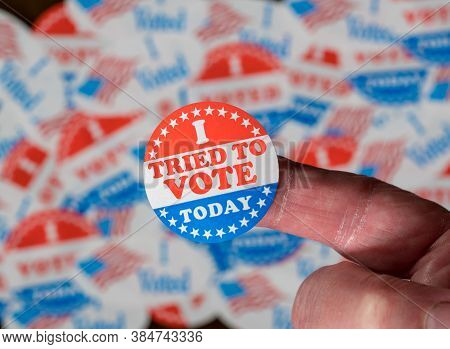 Finger With I Voted Button In Front Of Voting Stickers Given To Us Voters In Presidential Election T