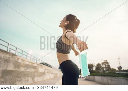 Focus Face Mask,  Asian Woman In Gym Clothes Taking Off Her Face Mask, Recovered From Coronavirus, C