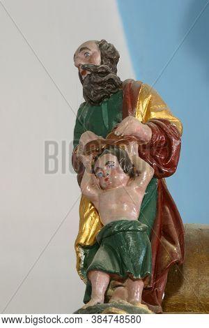 BEDENICA, CROATIA - JULY 25, 2011: Saint Matthew the Evangelist, statue on the main altar in All Saints Parish Church in Bedenica, Croatia