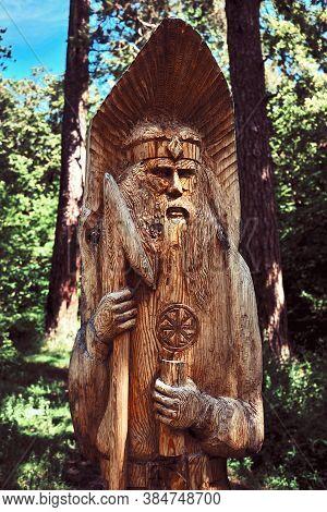 The Highland Of Slavic Perun God. Perun Slavic Pagan Idols On The Forest Temple. Ancient Wooden Idol