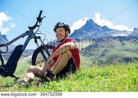 E Bike Bicycle In Austria. Man In Helmet With Mountain Ebike