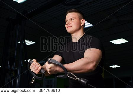 The Guy Is Doing A Pulling Exercise On The Pectoral Muscles.