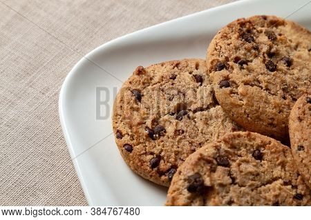 Home Made Chocolate Cookies Are In A White Plate On The Table