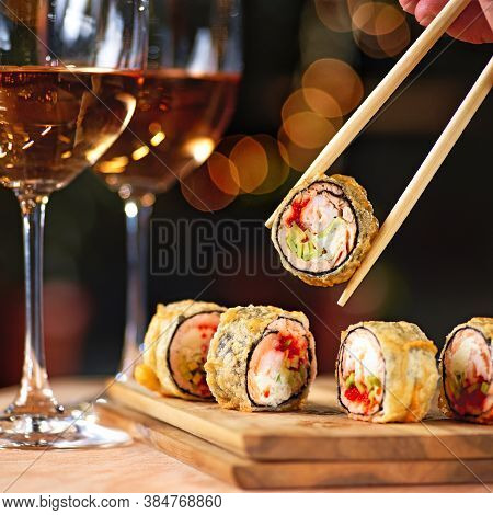 Hot Fried Sushi Roll With Salmon And Wine. Sushi Menu. Japanese Food. Hot Fried Sushi Roll