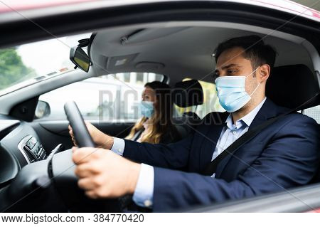 People Carpooling And Car Sharing With Face Masks