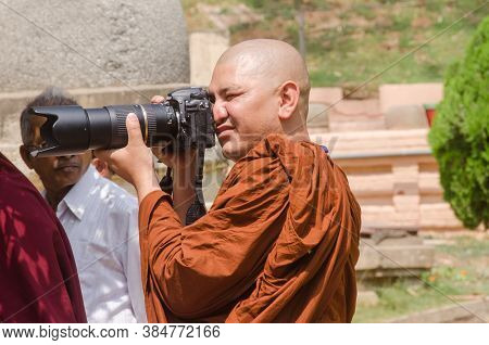 Bodh Gaya Bihar India April 30th 2018: A Lama Capturing Photograph At Bodh Gaya Bihar During Buddha