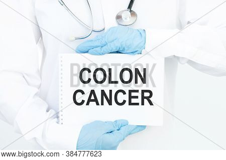 Doctor Holding A Card With Text Colon Cancer, Medical Concept