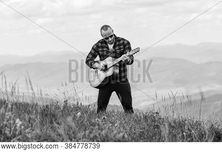 Acoustic Music. Keep Calm And Play Guitar. Man Hiker With Guitar On Top Of Mountain. Hiker Enjoy Nat