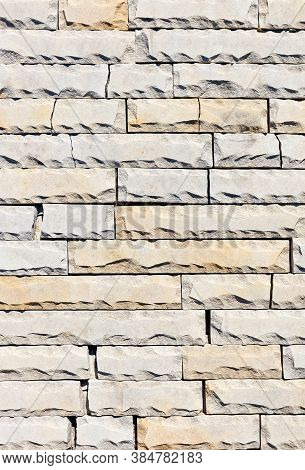 Background And Surface Texture Of Tiles Of Gray And Yellow Sandstone With Chipping And Cracks Along