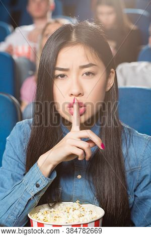 Silence Here. Portrait Of A Beautiful Asian Woman Asking For Silence With Shushing Gesture At The Lo