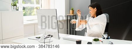 Woman Stretches At Office Desk. Stretch Exercise On Chair