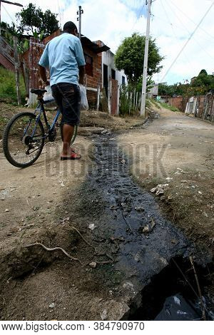 Itabuna, Bahia / Brazil - March 2, 2012: Open Sewage Leak Is Seen On Sao Francisco Street In Bairro