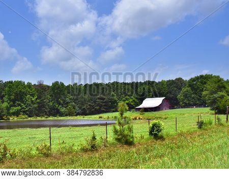 Barn And Pond On Farm