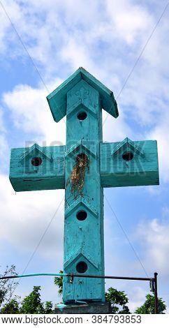 Cross Shaped Bird House With Nest
