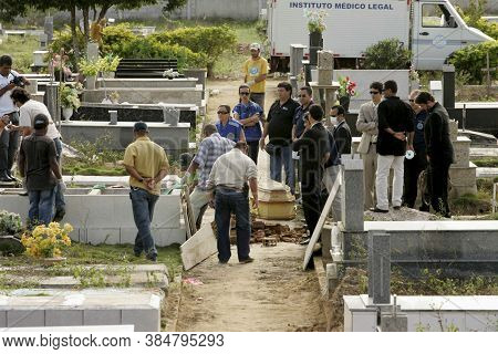 Teixeira De Freitas, Bahia / Brazil - July 11, 2009: Bahia Civil Police Officers Did The Exhumation