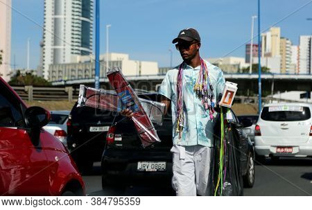 Salvador, Bahia / Brazil - May 21, 2014: People Sell Food Next To Vehicles With Open Suitcase In Sal