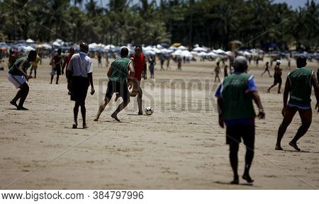 Salvador, Bahia / Brazil - October 26, 2014: People Are Seen Practicing Soccer Match At Piata Beach