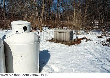 A Residential Standby Generator And Propane Tank