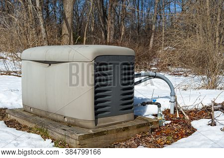A Residential Standby Generator On A Pad