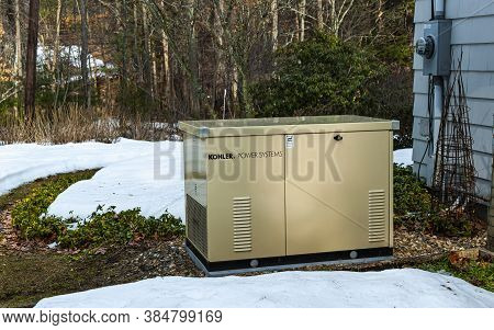 Newbury, Usa - February 24, 2017: Residential Standby Generator Installed On A Pad