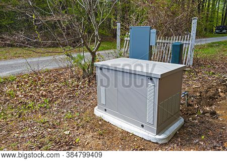 A Residential Standby Generator On A Concrete Pad