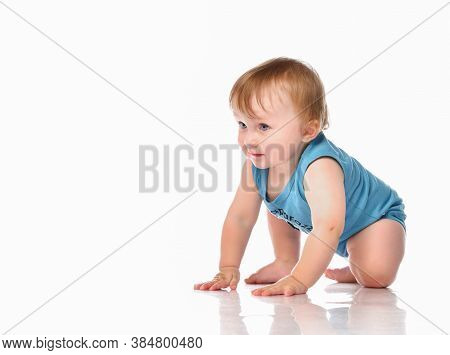 Infant Child Baby Boy Crawling And Happy Looking At The Corner Isolated On A White Background. Boy W