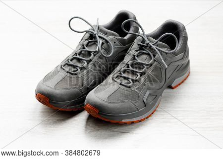 trekking sneakers with red sole, white background