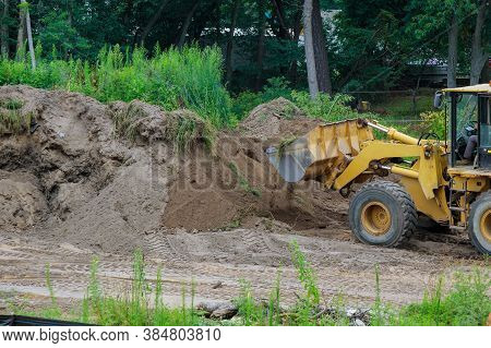 Backhoe Digging The Ground During Works At For Soil Construction Excavation Earthmoving
