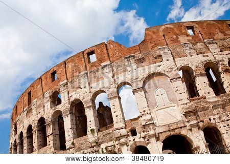 Arched Facade Of Ancient Landmark Amphitheatre Colosseum In Rome Italy