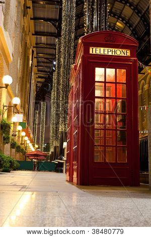 London Symbol Red Phone Box In Lightened Trade Passage