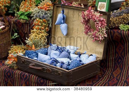Dried Wild Flowers And Handmade Decor In Old Fashioned Suitcase