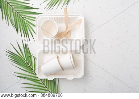 Eco Friendly Food And Drink Packaging On White Quartz Background