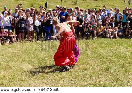 Dnepropetrovsk Region, Ukraine - June 2, 2018: Two Young Cossacks Fighting During The Ethno-rock Fes