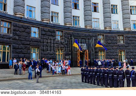 Kiev, Ukraine - August 23, 2019: Ukrainian Officials, Ministers And Police Officers Near The Buildin