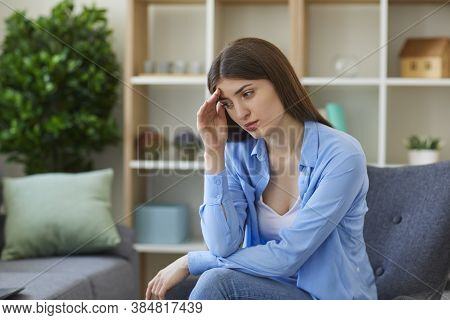 Young Sad Woman Feeling Bad And Touching Forehead With Hand