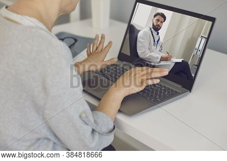 Woman Patient Communicating With Confident Man Doctor Therapist Onine During Videocall On Laptop