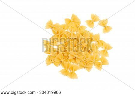 Uncooked Farfalle Pasta Isolated On White Background. Top View. Heap Of Dry Farfalle Pasta. Bow Tie