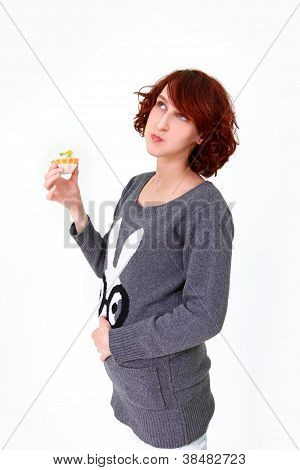 Girl eating cake and holding his stomach isolated on white background poster