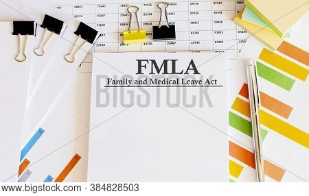 Paper With Family Medical Leave Act Fmla On Table