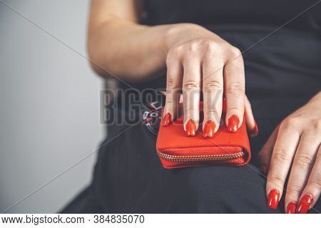 Woman Holds A Red Leather Purse In Her Hands. Money And Shopping. Womans Hands With Wallet