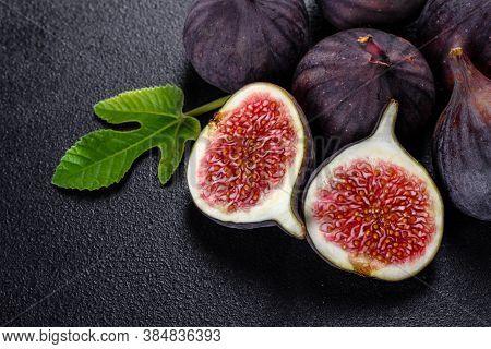Fresh Ripe Figs On A Dark Concrete Background. Harvesting Figs