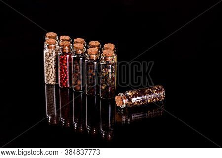 Small Glass Jars With Corks With Various Spices Inside